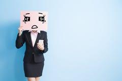 Panneau d'affichage de prise de femme d'affaires Photographie stock libre de droits