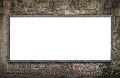 Panneau d'affichage vide sur le mur en pierre Photographie stock libre de droits