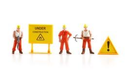 Panneau d'avertissement en construction avec le chiffre miniature labo Photo stock