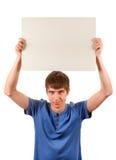 Panneau de blanc de prise de jeune homme Images stock