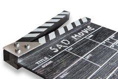 Panneau de clapet sur le film triste de titre blanc de fond Images stock