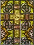 Panneau de fenêtre de croix en verre souillé Photographie stock