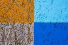 Panneau de fibres agglomérées blanc bleu orange avec quatre rectangles avec éplucher la peinture Texture de surface approximative photo stock