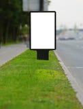 Panneau de publicité sur un bord de la route Images libres de droits
