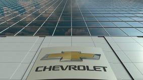 Panneau de Signage avec le logo de Chevrolet Façade moderne d'immeuble de bureaux Rendu 3D éditorial Photo libre de droits