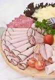 Panneau des parts de jambon et de viande Photographie stock libre de droits