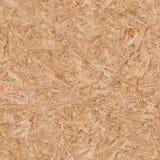 Panneau en bois pressé (OSB). Texture sans couture. Photo stock