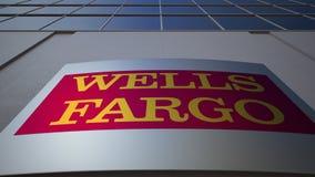 Panneau extérieur de signage avec le logo de Wells Fargo Immeuble de bureaux moderne Rendu 3D éditorial Photo stock