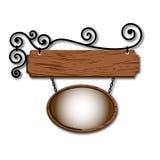 Panneau indicateur en bois avec les enroulements Photos stock