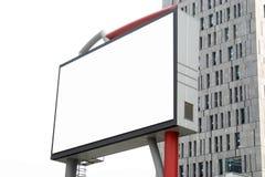 Panneau-réclame blanc dans la construction Photographie stock libre de droits
