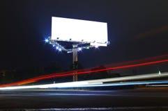 Panneau-réclame la nuit Photo stock