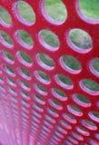 Panneau rouge perforé photos libres de droits