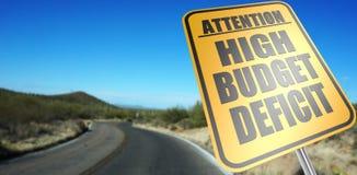 Panneau routier élevé de déficit budgétaire image libre de droits