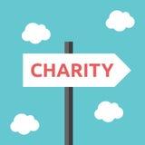 Panneau routier de direction de charité Image libre de droits