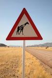 Panneau routier de girafes de danger Photos libres de droits