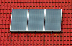 panneau trois solaires photographie stock