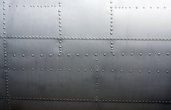 Panneautage en métal d'un aéronef de cru Photographie stock libre de droits