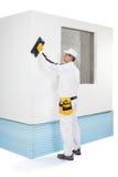 Panneaux d'isolation de râpage de travailleur Photographie stock libre de droits