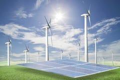 Panneaux solaires, turbines de vent sur l'herbe verte avec le backgrou de ciel bleu images libres de droits