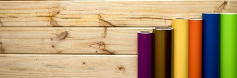 Panned colorful vinyl rolls on wooden background royalty free stock images