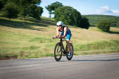 Panned shot of bicyclist. In biking gear riding fast Royalty Free Stock Photos