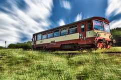 Panned shot of a train passing by. A panned shot of a train passing across the countryside lending a visual effect to the background Stock Photos