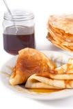 Pannekoek met honing Stock Foto