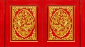 Pannelli rossi e dorati abile elaborati Fotografia Stock