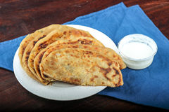 Panner Paratha, Cottage cheese pizza. Panner (Indian name for cottage cheese) Paratha, Indian Food, Punjabi Food, Cottage cheese pizza Stock Images