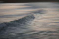 Panning. With a breaking wave Stock Photography