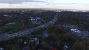 Panning aerial view of Interstate highway 476 Blue Route in Radnor Township, Villanova, Pennsylvania. A Panning aerial view of Interstate highway 476 Blue Route stock video