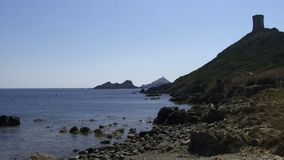 Panning along the coastline in Corsica. The coastline in Corsica panning shot stock footage