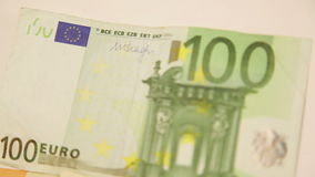 Panning around euro banknotes stock footage