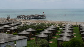 Panning of beach and villas at the luxury hotel. Antalya, Turkey stock video footage