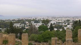 Panning beautiful landscape with city and trees from ancient Carthage ruins, Tunisia stock video