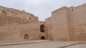 Panning view of brick walls of ancient fortress Ribat in Monastir, Tunisia. Panning beautiful view of brick walls of ancient fortress Ribat of Monastir stock footage
