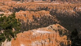 Panning bottom up sand mountain red orange Bryce Canyon National Park 4k. On observation point, panning bottom up sandstones mountains of red orange and white stock video