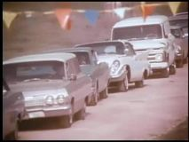 Panning cars lined up to get into event stock footage