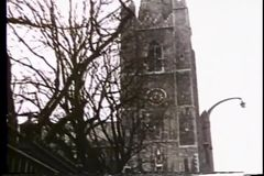 Panning from church steeple to busy village street stock video footage