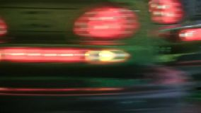 Panning Close-up of Bumper Cars. At a town fiesta, fun fair. Glittery vehicles and smooth motion, flashing abstract lights stock video footage