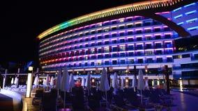 Panning down the building of luxury hotel in night illumination. Antalya, Turkey stock footage