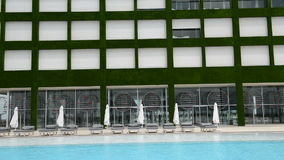 Panning down of building and swimming pool at the modern luxury hotel stock video footage