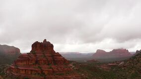 Panning drone shot of Red Rock Formations On A Rainy Day In Sedona, Arizona