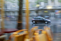 Panning effect car rainy day Stock Photography