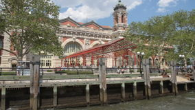 Panning Ellis Island from ferry. Panning Ellis Island while departing ferry dock stock footage