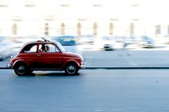 Panning. Fiat500 on the road in a summer day Stock Photo