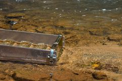 Panning for gold with a sluice box Royalty Free Stock Photos
