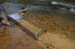 Panning for gold with a sluice box Royalty Free Stock Photography