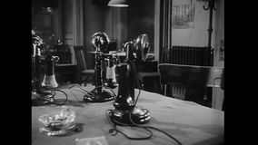 Panning group of old-fashioned telephones on table