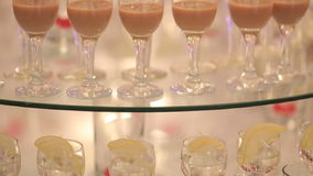 Panning holiday buffet table with alcohol drinks. Shots are on the table stock video